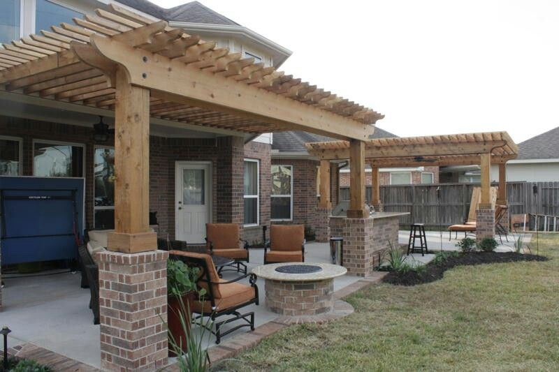 extended patio with brick border shade arbors firepit outdoor kitchen - Extended Patio Ideas