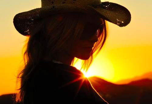 cowgirl at dusk