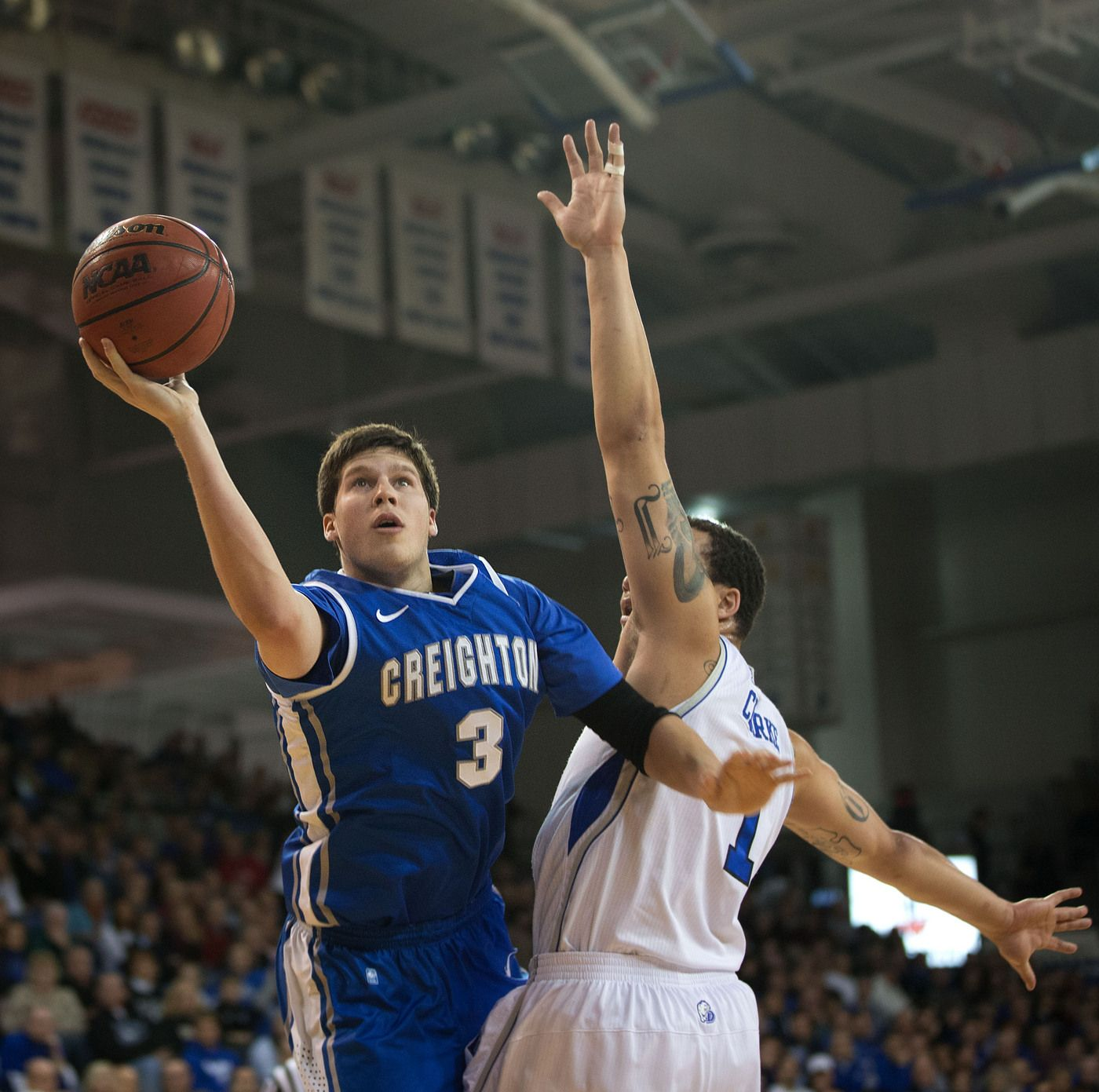 CU's Doug McDermott (3) goes to the hoop and gets could by