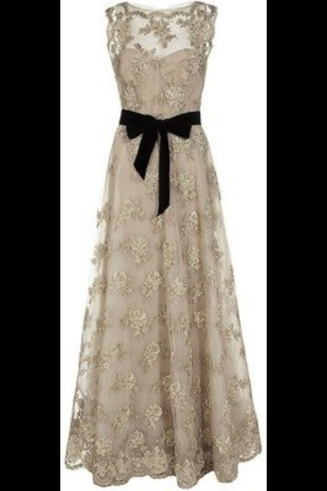 Cute and elegant lace dress embellished with a black ribbon