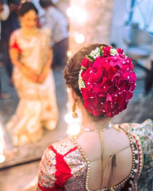 Big Bun With Rose Petals Bridal Hairdo Indian Wedding Hairstyles Bridal Hair Buns