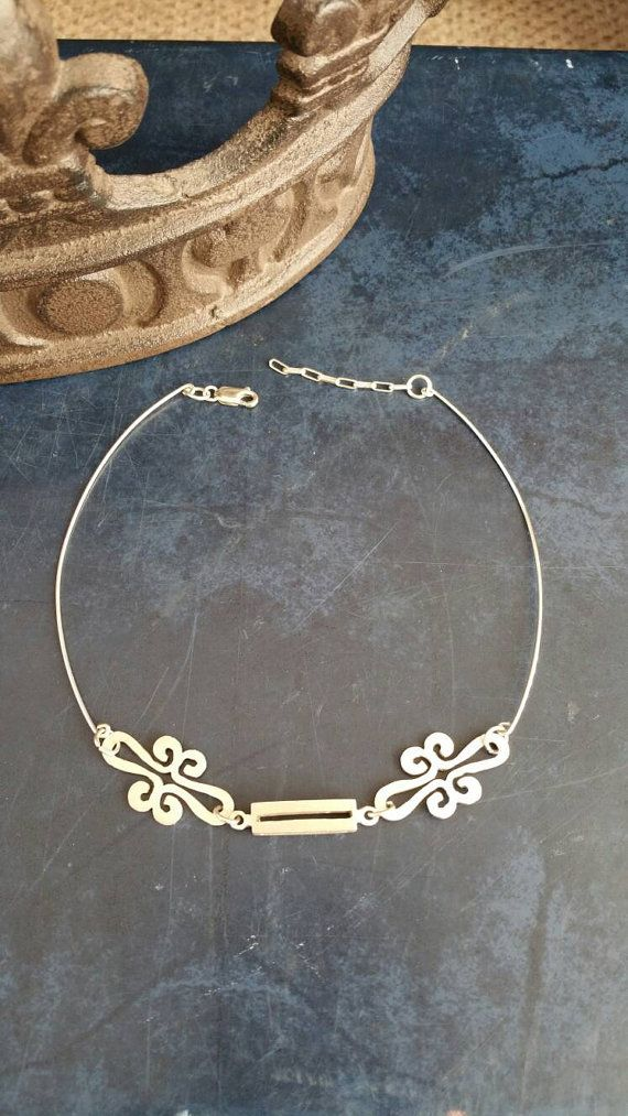 Check out this item in my Etsy shop https://www.etsy.com/listing/474324872/stearling-silver-choker-designer-jewelry