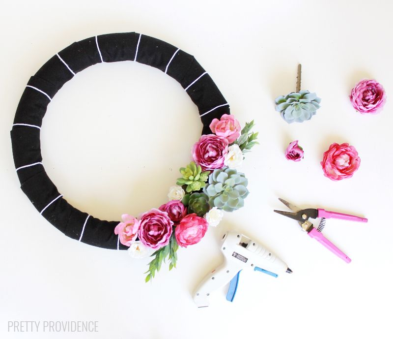 DIY Modern Floral Wreath - a simple and beautiful wreath wrapped in felt and topped with flowers and mini succulents.