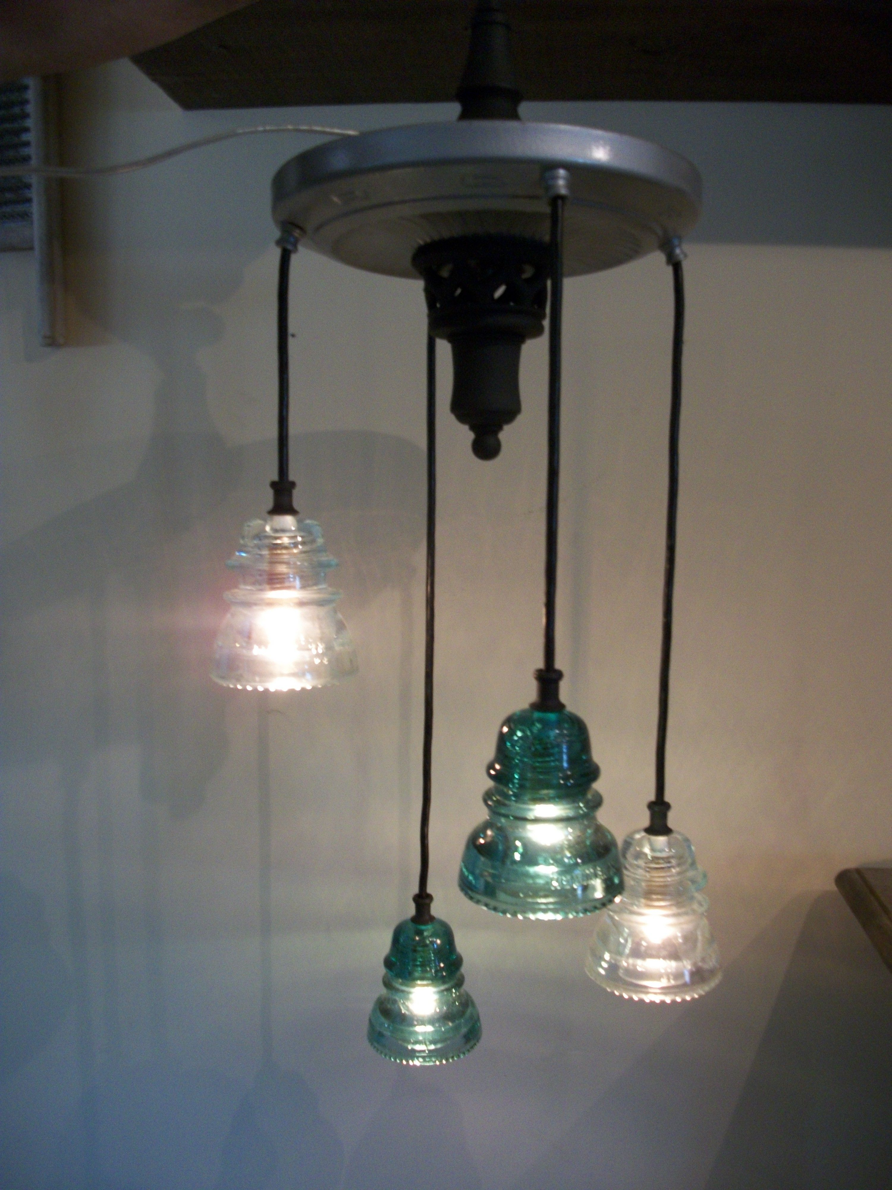 Glass insulator chandelier antique glass from the for Antique insulator pendant lights