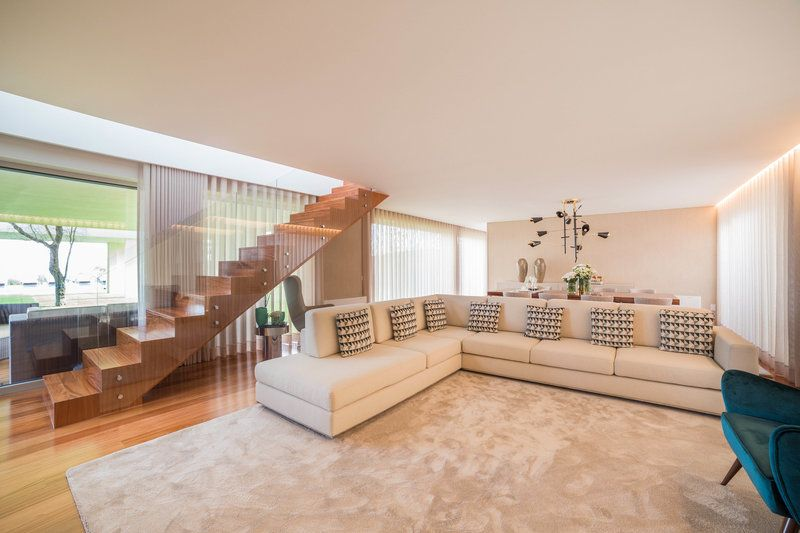 contemporary living room view cream l shape sofa and wood stairs garden area view - L Shape Garden Decor