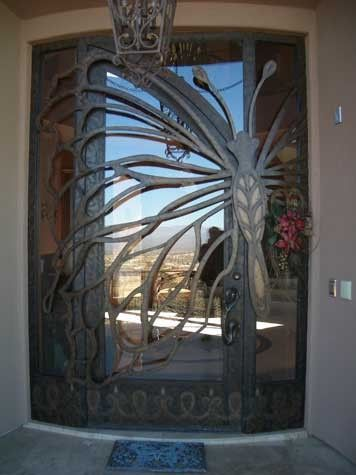 Glass Butterfly Door - This has to be one of the most unique front doors I  have ever seen. The butterfly is incorporated into the entire str.