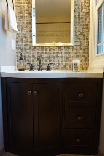 Image On this our bathroom remodel got Madeline Collection inch vanity honey wheat backsplash from Menards x inch mirror from Bed Bath u Beyond