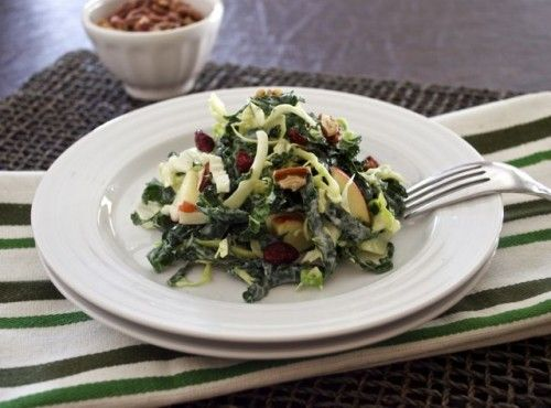 Kale and Napa Cabbage Salad with Greek Yogurt Dressing is ribbons of kale and Napa cabbage combined with apples, dried cranberries, and toasted pecans in a creamy, Greek yogurt dressing. This salad is one great way to eat your greens in a very delicious, different way!