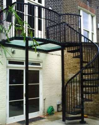 After Image Of The Glass Balcony Garden With Spiral Staircase