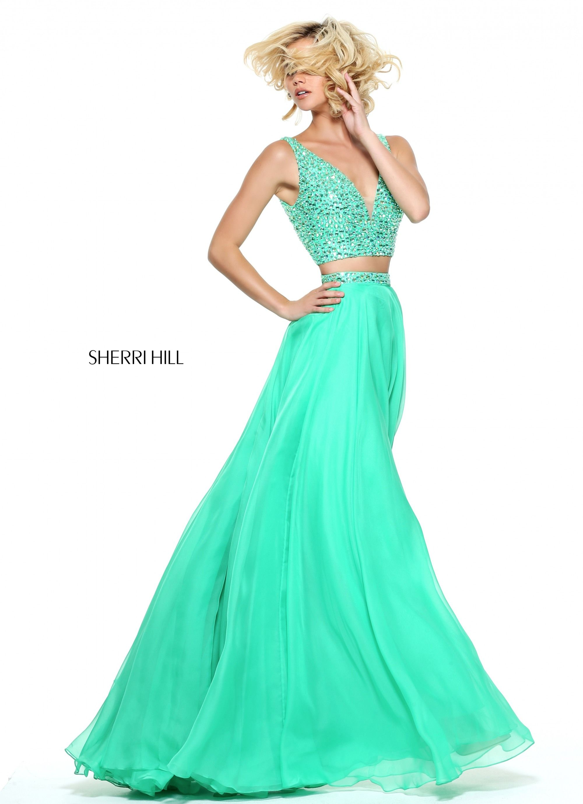577b2f5a338 Sparkling tonal beadwork coats the V-neck and V-back crop top of this Sherri  Hill 51008 two-piece prom dress