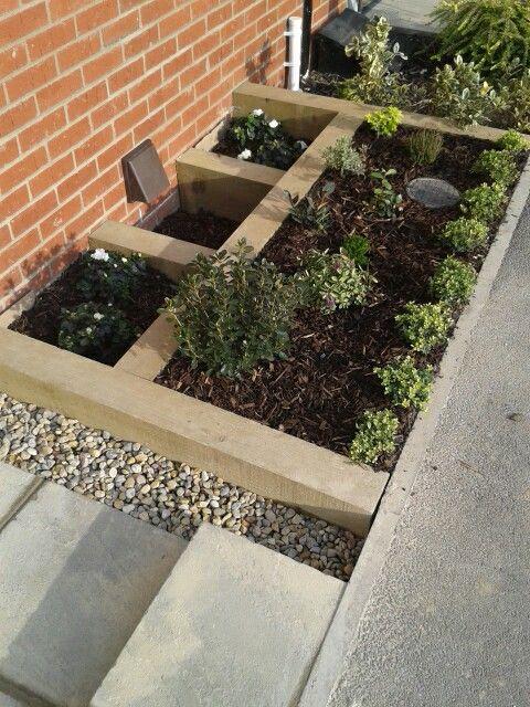Small terraced front garden railway sleeper tiered garden ...