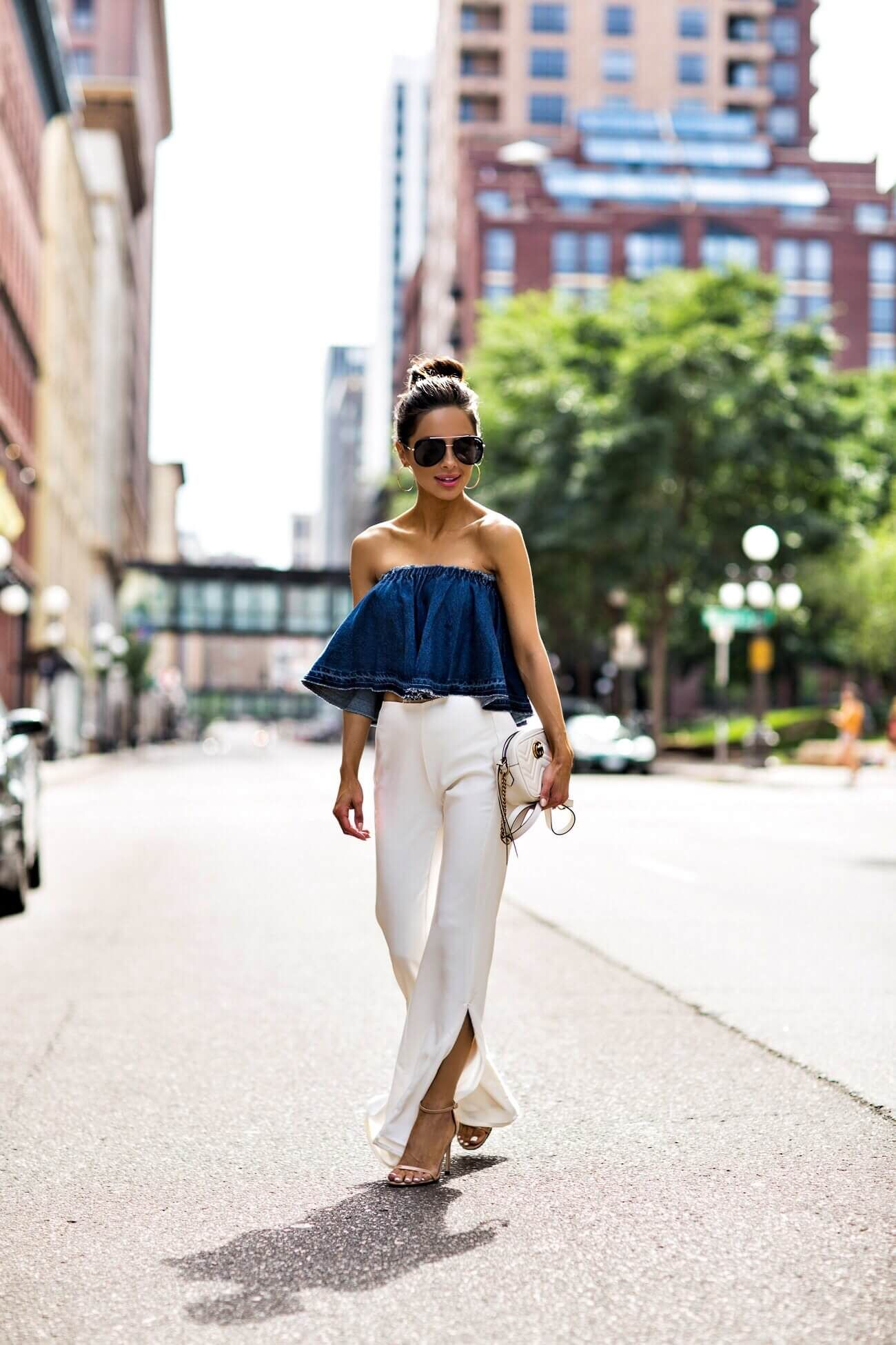 fb91a20662c fashion blogger mia mia mine wearing a denim strapless top and white pants  from revolve