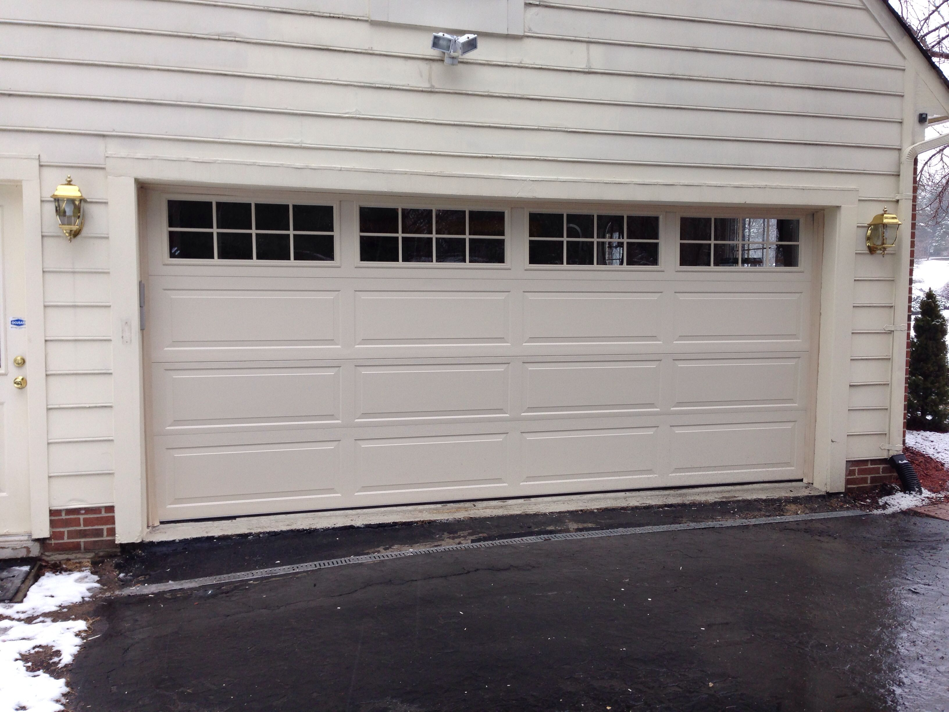 High Insulated Steel Carriage Garage Door With Extra Large Windows In Potomac Md By Crisway Doors Garage Doors Broken Garage Door Garage Door Opener Repair