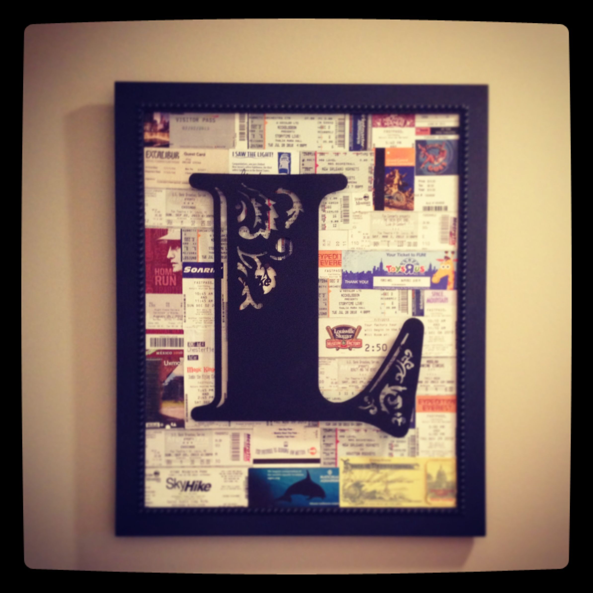 Shadow Box Is Backed With A Collage Of Sports Ticket
