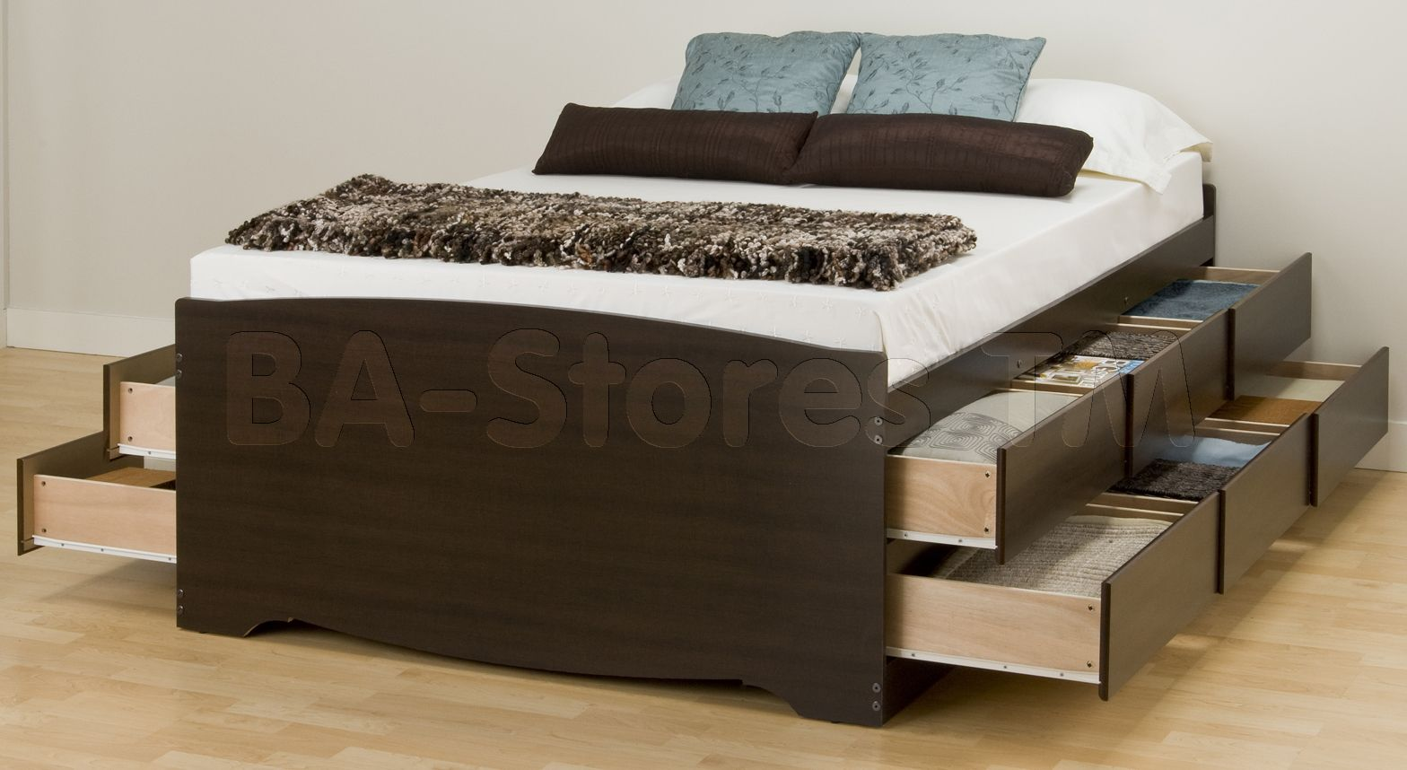 queen platform bed with 12 drawers and there are pillows and blanket