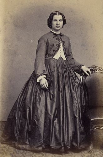 A trendy young lady in the Civil War era - Garibaldi blouse and jacket and short curls