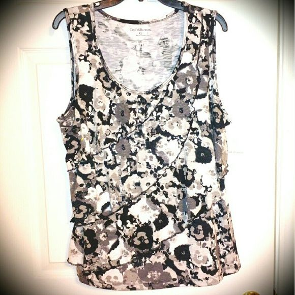 Black &  white ruffled tank top Black and white ruffled tank top.... There are 3 sets of ruffles running diagonally.... You can see the the best in the first pic Croft & Barrow Tops Tank Tops
