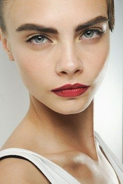 Cara Delevingne working the red lips at Jason Wu.