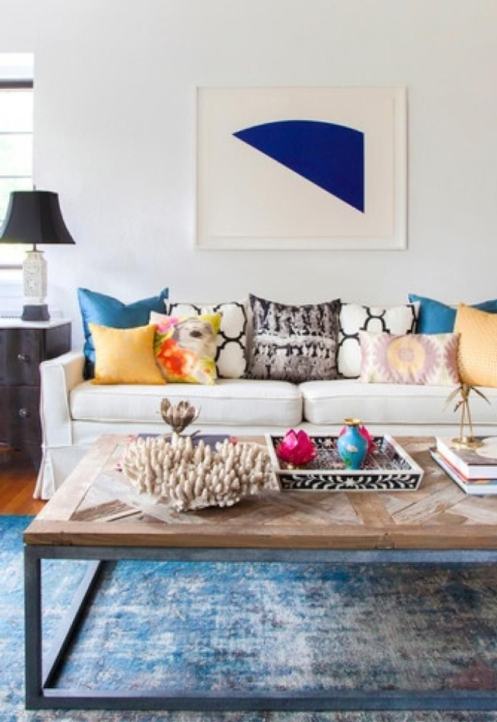 Bright Eclectic Living Room With Elegance Sofa And Black Arch Lamp ...