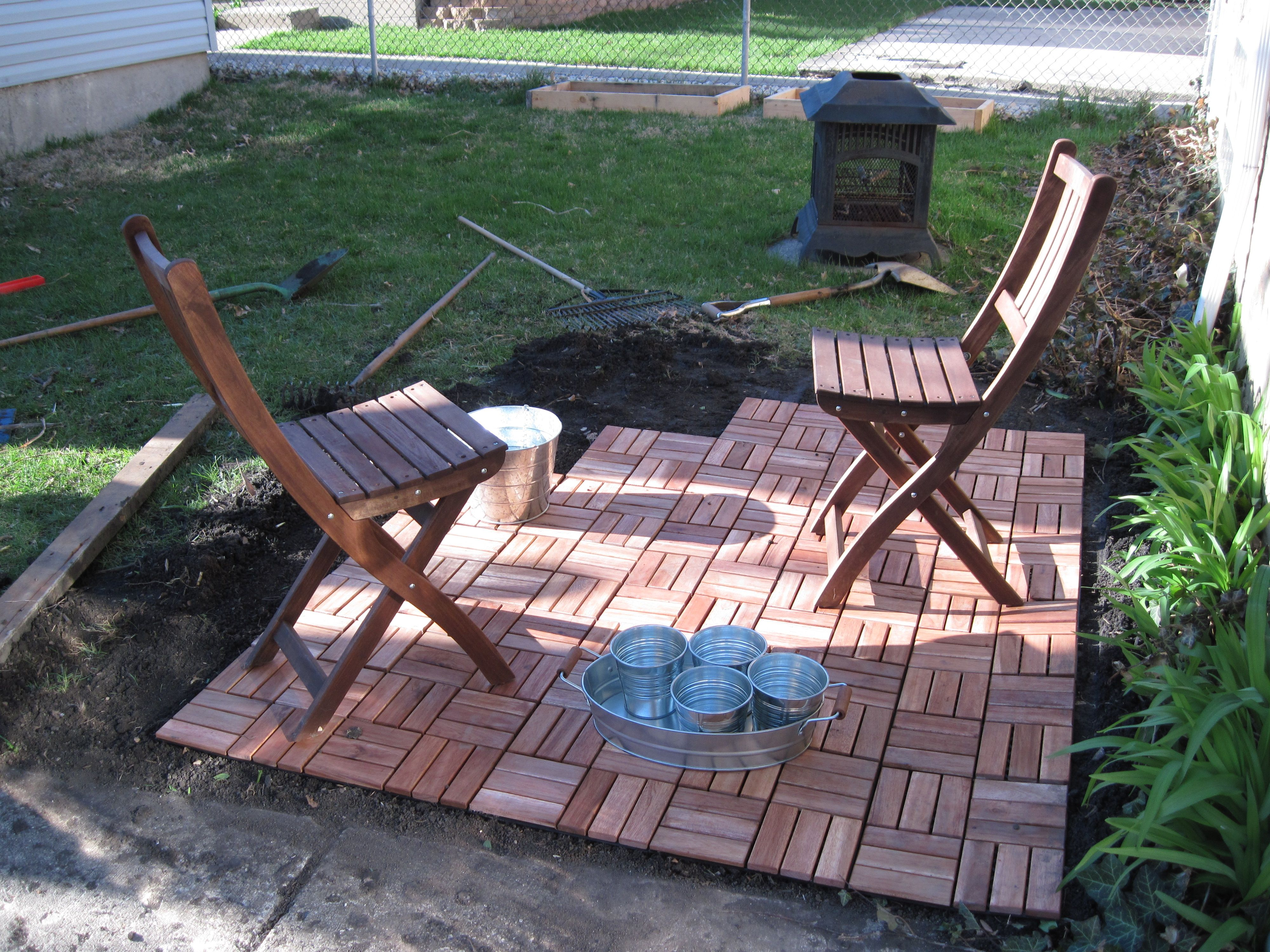 Backyard plans coming together decking backyard and curb appeal ikea patio tiles directly on ground dailygadgetfo Images