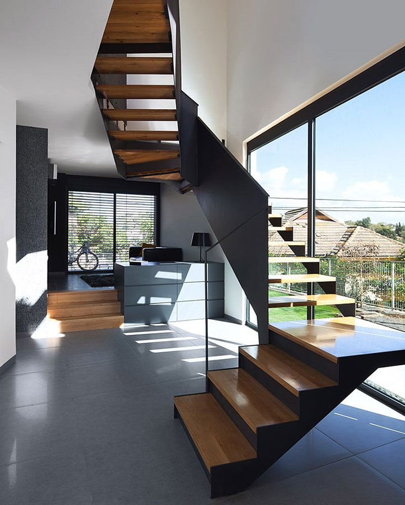 Light coloured ceramic floor tiles combined with  dark toned timber stair makes the room look more spacious also rh za pinterest