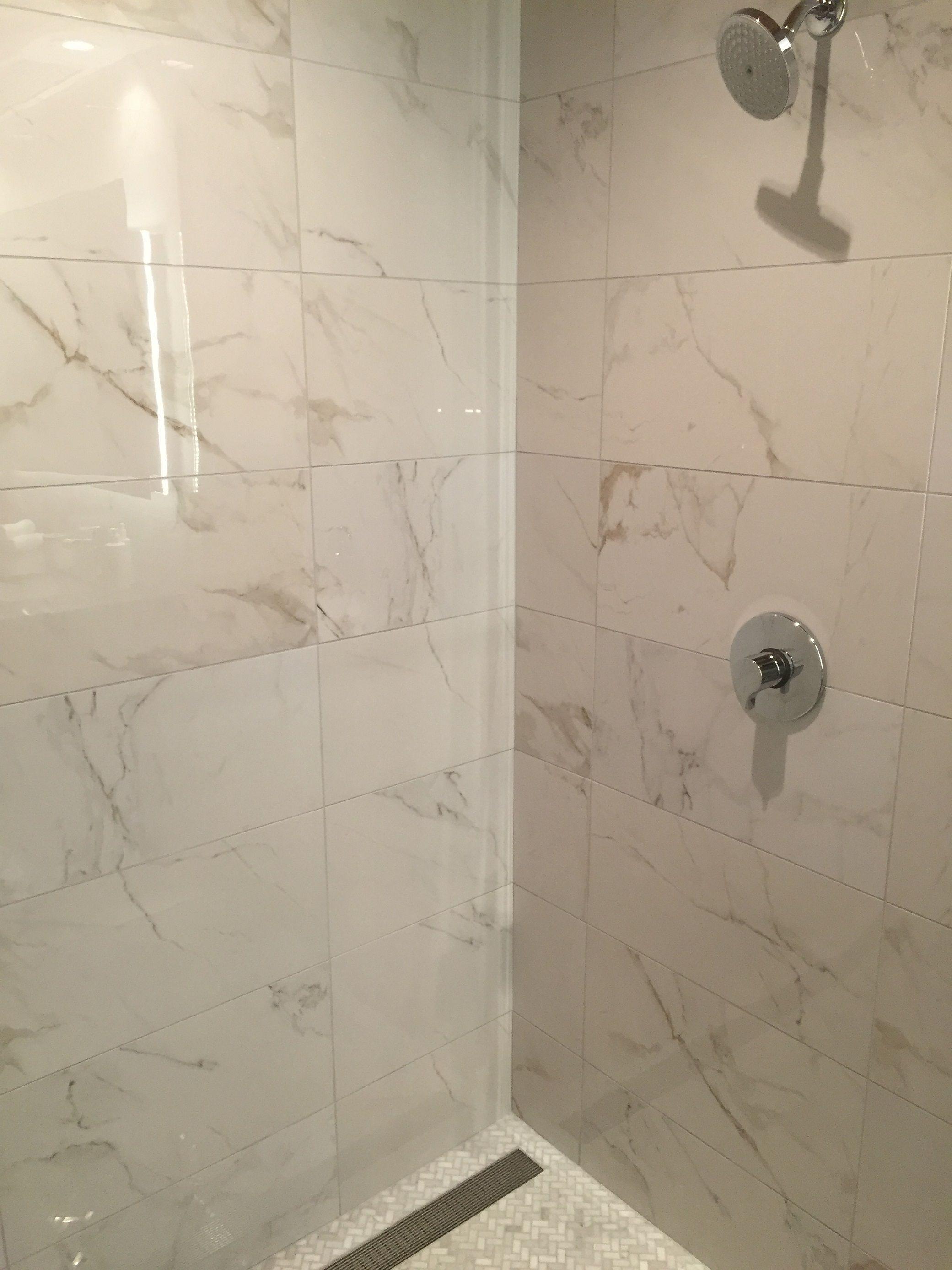 Calcutta polished porcelain looks just like marble see it - Marble look bathroom floor tiles ...