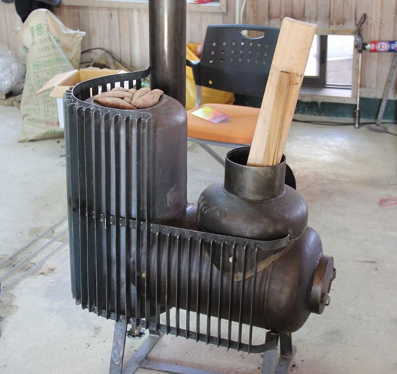 John clark pinterest stove rocket for Rocket stove home heating
