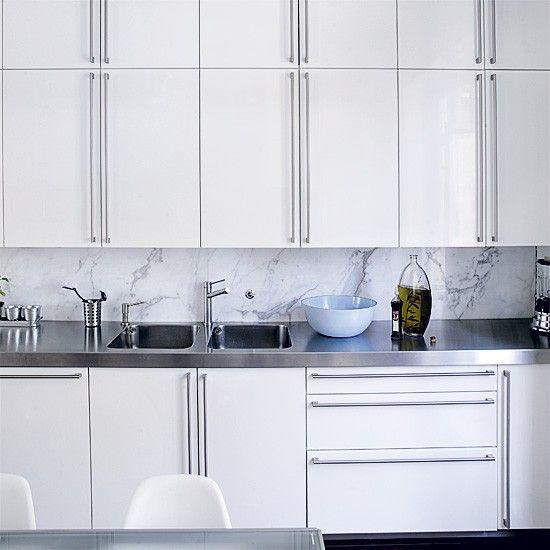 Sleek Fitted White Kitchen A Rich Carrara Marble