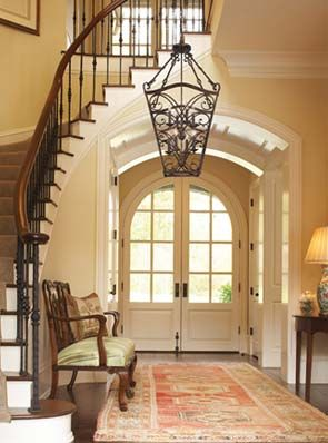 Beautiful foyer and staircase arched doors interior design