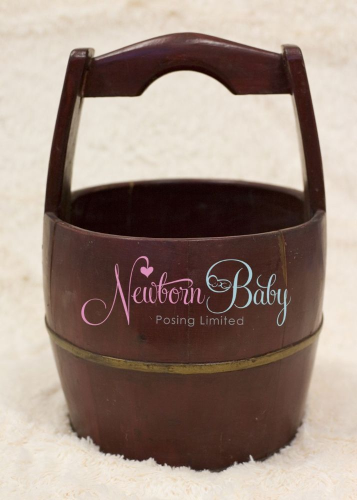 An old bucket that has been restored. A newborn photography prop from Newborn Baby Posing Limited - home of the posing beanbag.