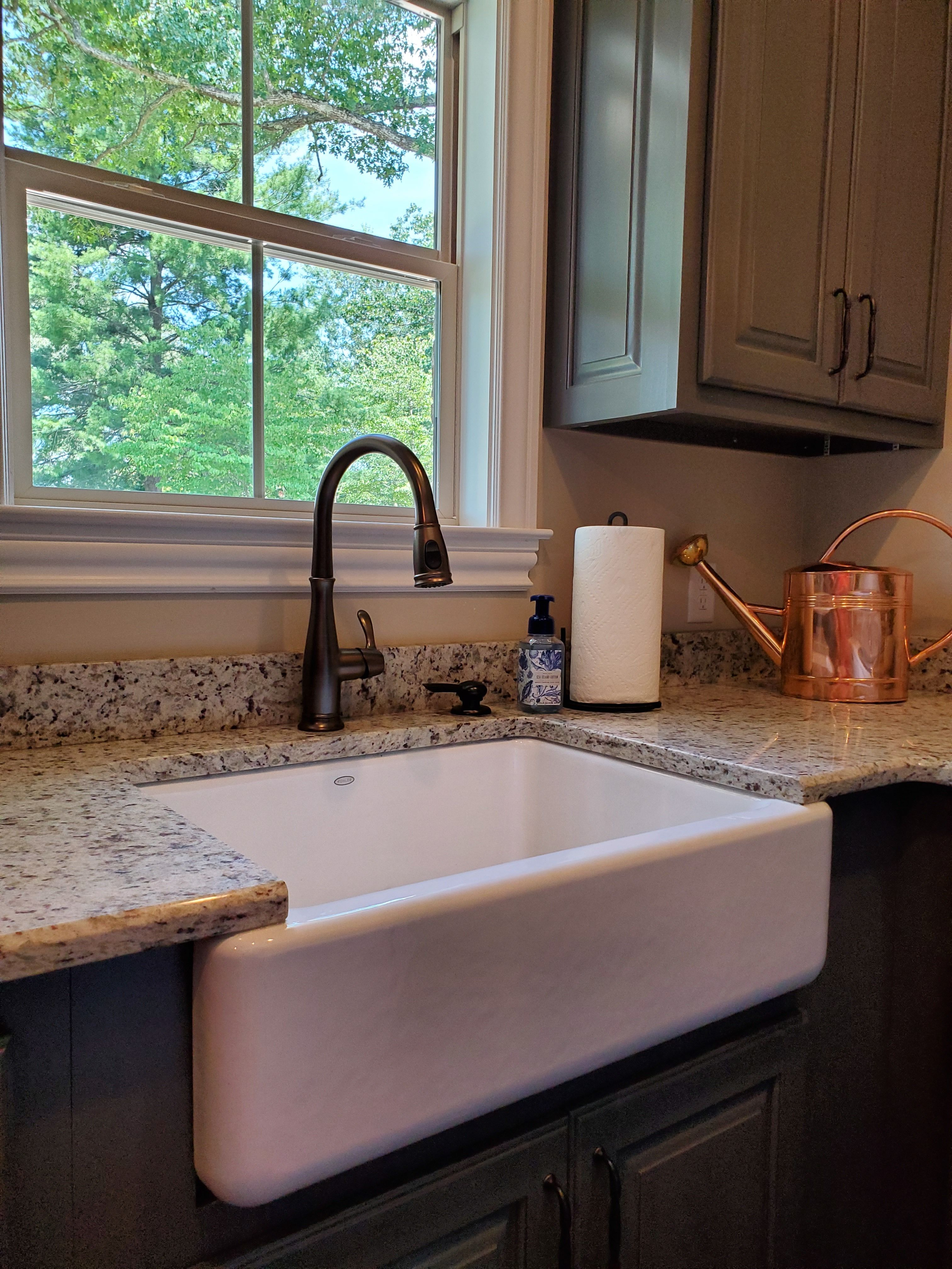 white porcelain farmhouse kitchen sink with granite countertops by bison countertops on farmhouse kitchen granite countertops id=96425