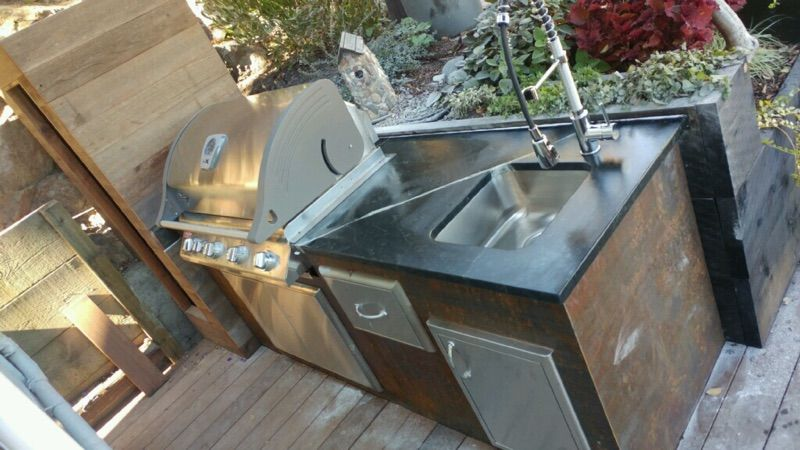 Outdoor Bbq Counter In Cartorio Soapsone With Undermount Sink