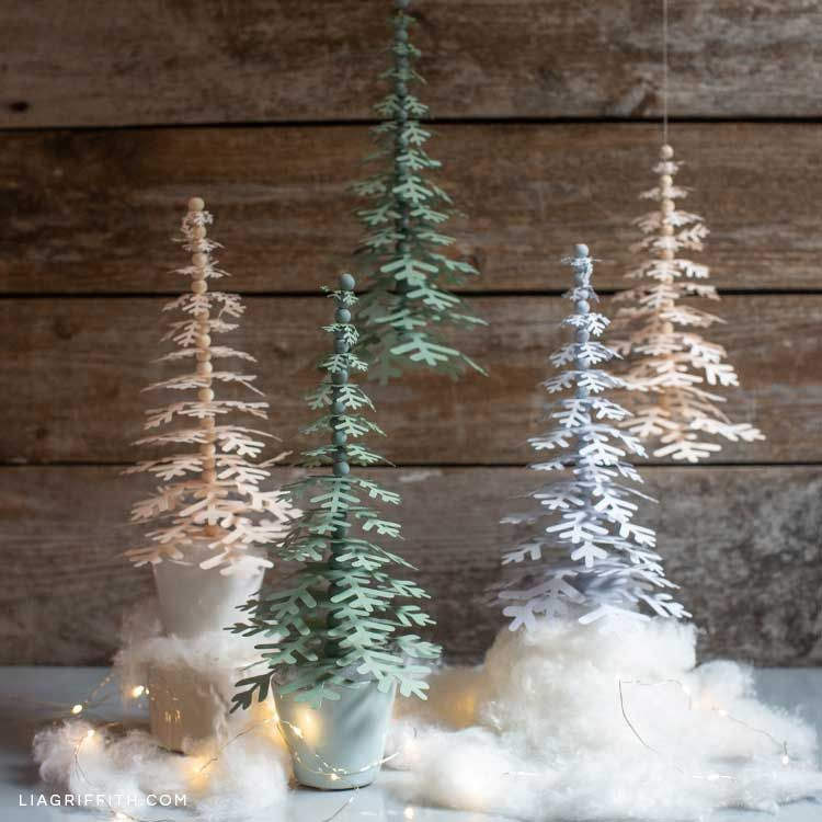 Paper Snowflake Trees For Your Holiday Decor Lia Griffith Paper Christmas Decorations Holiday Tree Holiday Mantel