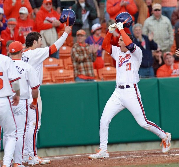 Clemson S Shane Kennedy Right Is Greeted At Home Plate By His Teammates After Hitting A Two Run Home Run In The Eighth College Baseball Ncaa College