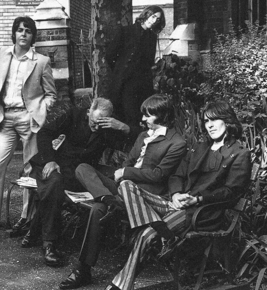 Beatles - Mad Day Out location #5, St Pancras Old Church and Gardens, near Regents Park. The man on the bench continued to read his paper and ignore the Beatles as they invaded his privacy.