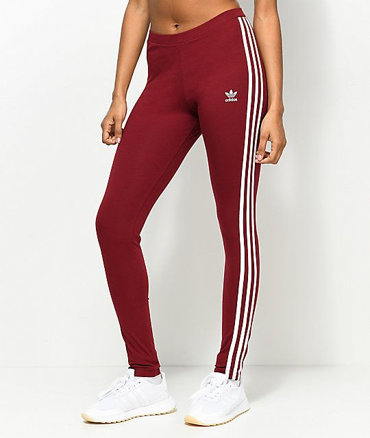 An on-point streetwear athlook starts with the adidas 3 Stripe Leggings.  These burgundy leggings feature 3 stripes down the sides and an embroidered  adidas ... ce34f038dac