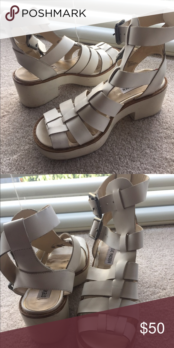 Chunky Gladiator Platform Sandals White Steve Madden chunky platform sandals- the gladiator part of the sandal is white, and the heel/platform part is off-white. The soles are lined with light brown. There is a double buckle for the ankle straps. They're in great condition. They show signs of wear only on the soles and very slight discoloration on the buckle part of the straps. Steve Madden Shoes Sandals