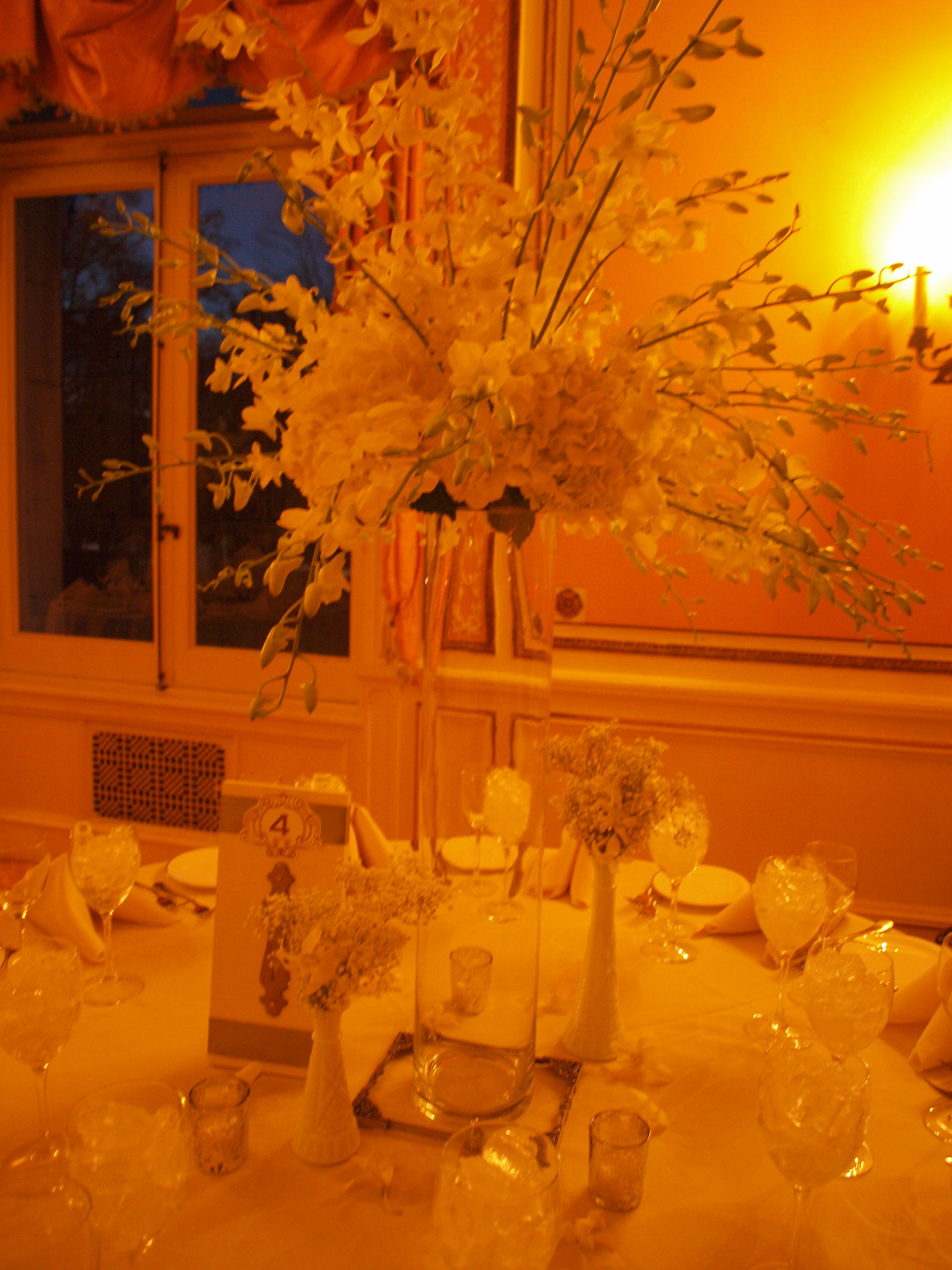 White hydrangea white orchids, milk glass,gypsophilia. table numbers: vintage doors/ place cards were tied to a vintage key...very Cairnwood estatish....