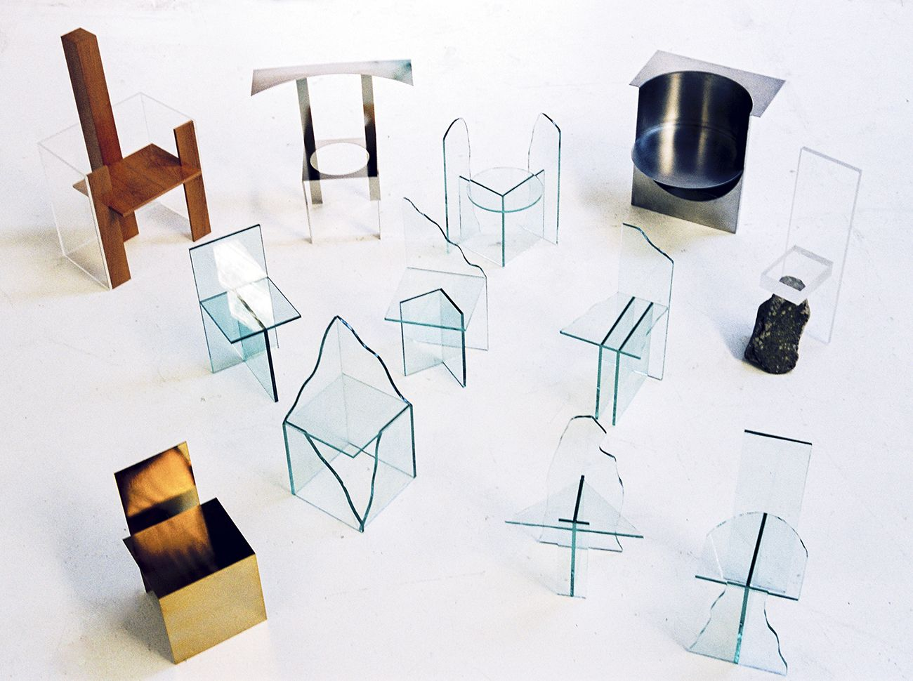 Guillermo Santomá's new furniture includes aseries of organic, landscape-like glass chairs as well as a more geometric, Kuramata-esque collection of five.