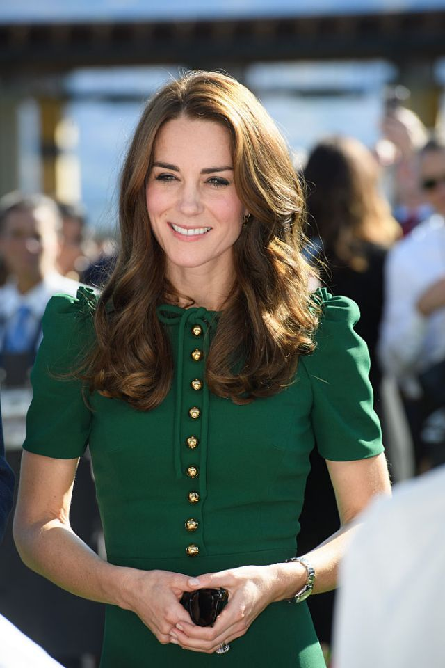 <p>For the tour,the Duchess let her hair down, opting for long waves with her go-to middle part. <i>(Photo by Pool/Sam Hussein/WireImage)</i></p>