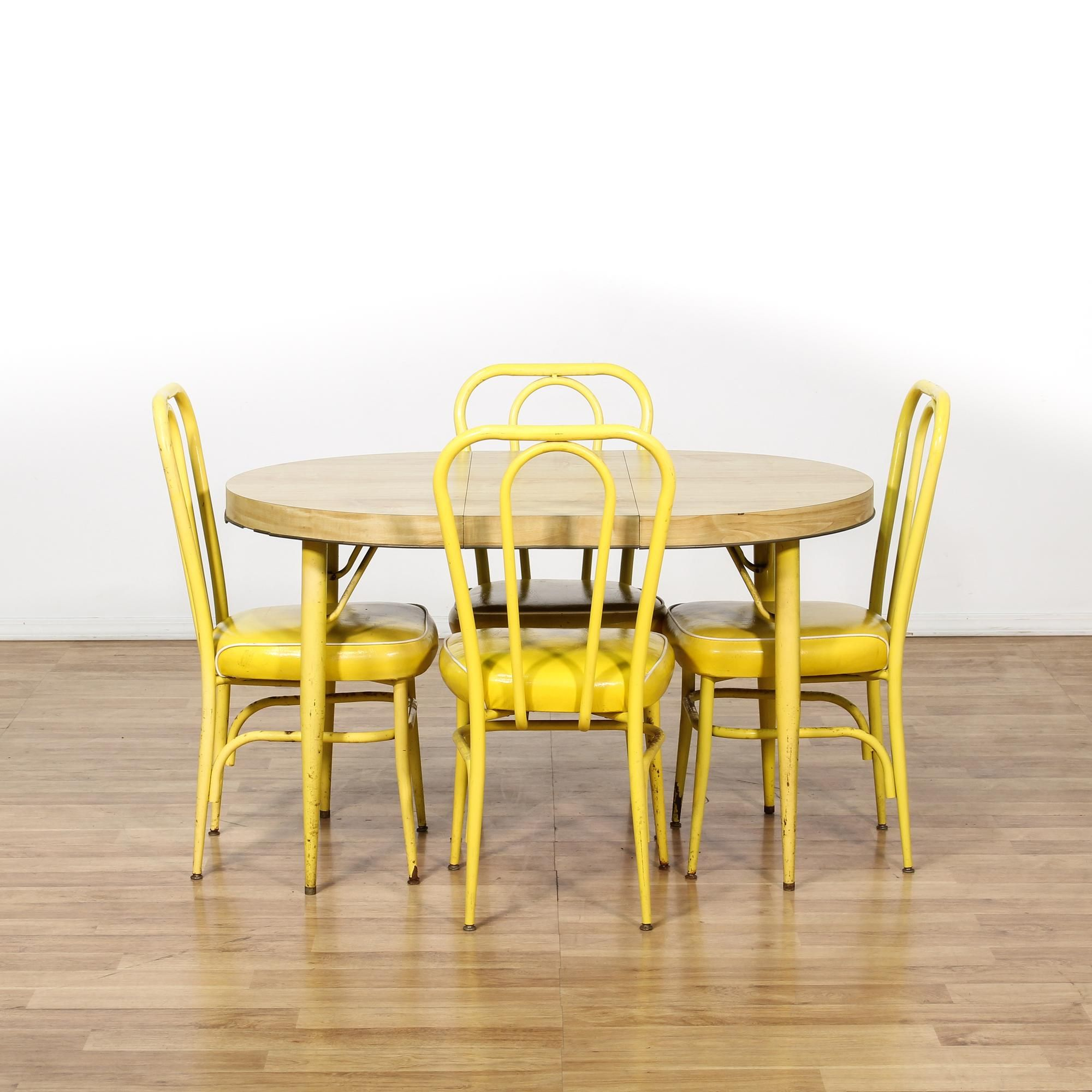 This Mid Century Modern Dining Set Is Featured In A Durable Metal With A  Distressed Vibrant