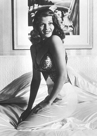 92151a14c3c Rita Hayworth s famous pose in a black negligee quickly made its way across  the Atlantic in 1941