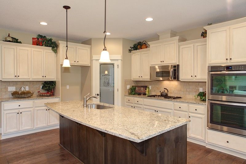 Large gourmet kitchen with custom vanilla bean cabinets