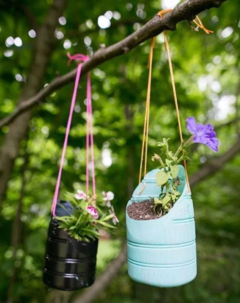 Image result for hanging planters from plastic bottles