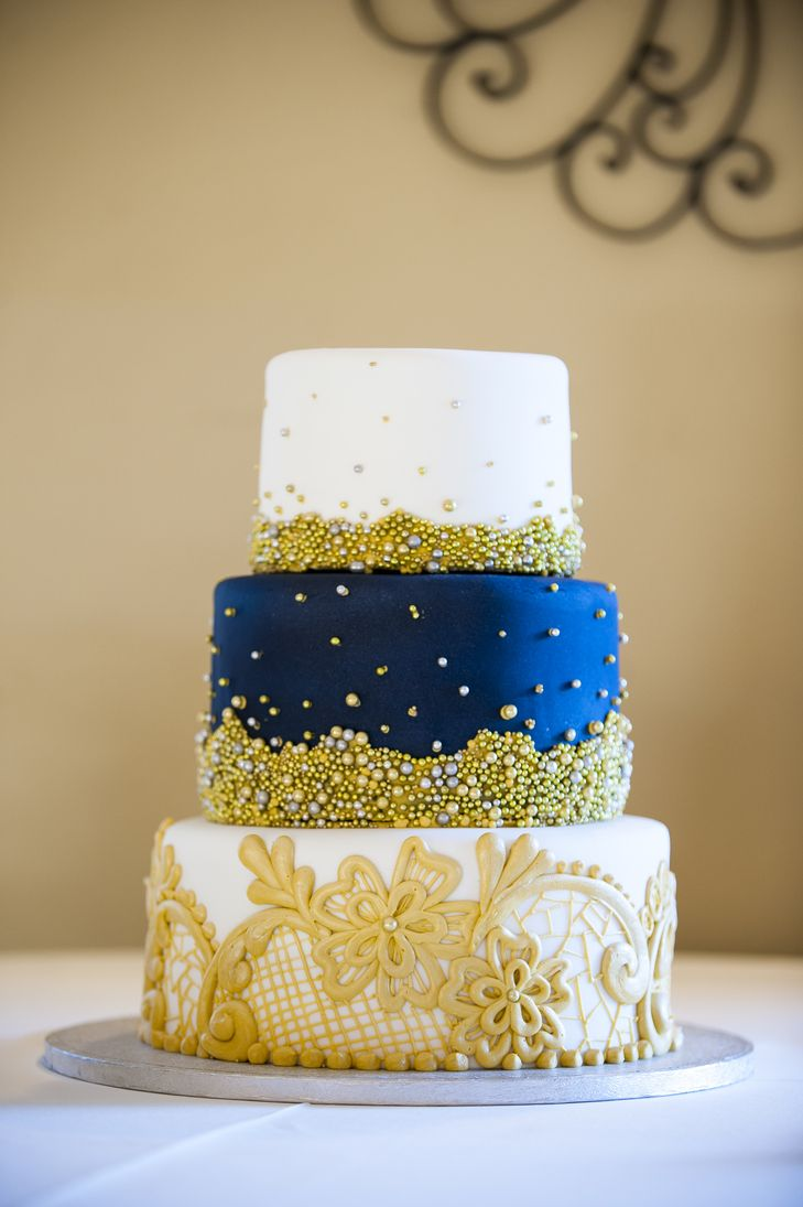 Intricate Designs on Tiered Navy, Gold and White Wedding Cake ...
