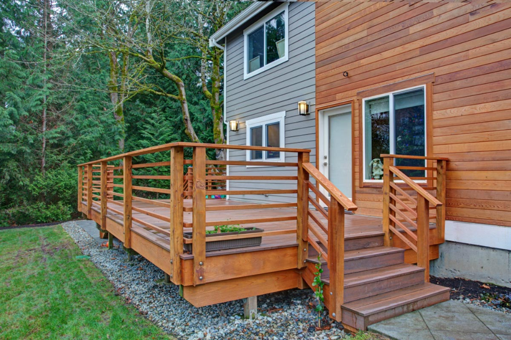 Raised Wooded Walkout Deck Construction With Railing Stairs And Steps In 2020 Building A Deck Wooden Decks Wood Deck