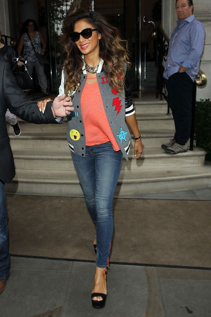 Leaving a Kiss FM interview, Nicole Scherzinger was wearing a patchwork iiJin letterman jacket paired with a casual pair of jeans and coral-colored top. [Photo by Neil P. Mockford/GC Images]
