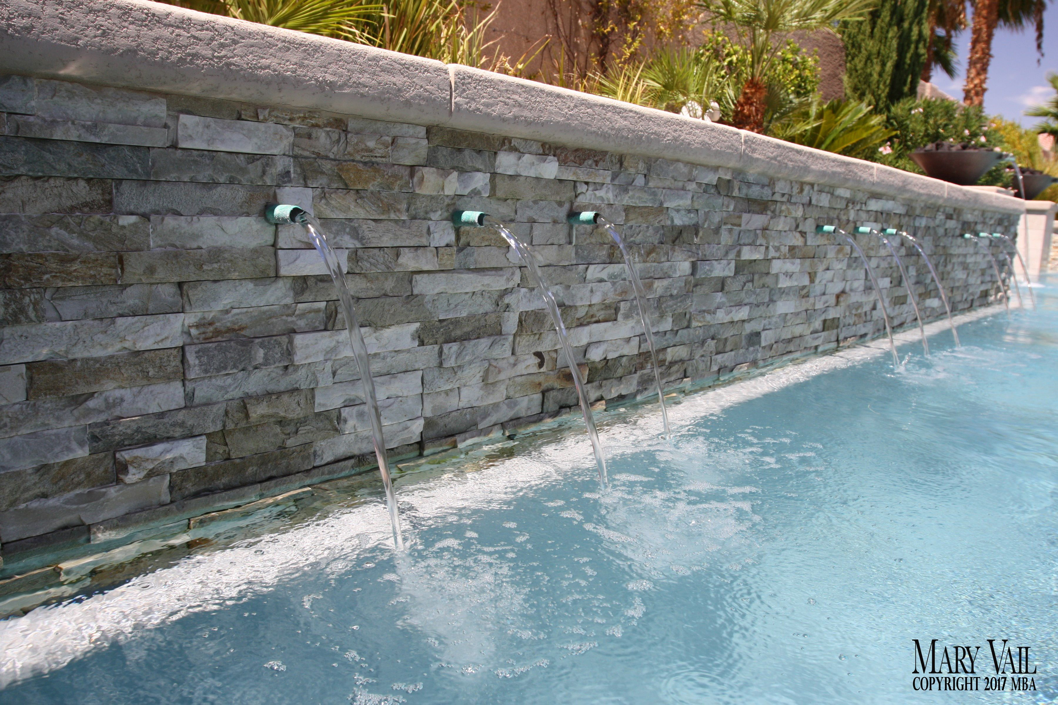 Into A Pool With Copper Water Spouts Custom Pools Pool