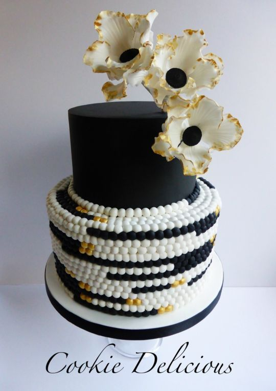 black & gold wedding cake www.tablescapesbydesign.com https://www.facebook.com/pages/Tablescapes-By-Design/129811416695