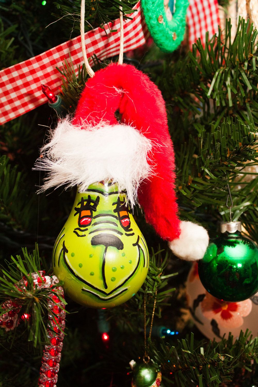 I M Generally Not A Huge Fan Of Homemade Ornaments But This Lightbulb Grinch Is Cool Light Bulb Ornaments Tea Light Crafts Christmas Crafts
